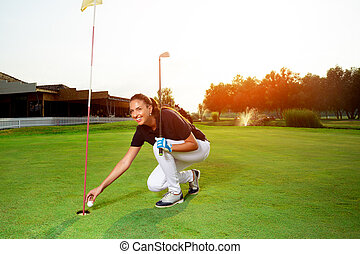 Female golf player with a golf club