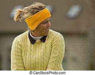Female golfer ready to swing