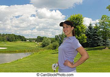 Female golfer relaxing on the fairway