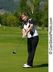 Female golfer - Blond female golfer on the putting green
