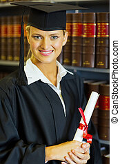 female graduate in university library - happy female law...