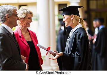 female graduate talking to parents