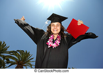 Female graduate with diploma over blue sunny sky