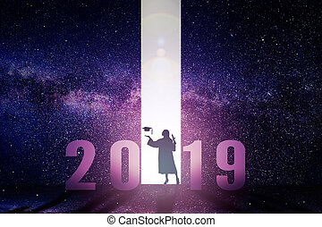 female graduation standing with 2019 new year concept