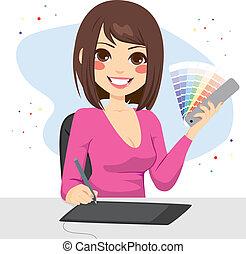 Beautiful female graphic designer showing pantone color chart palette