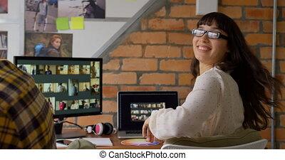 Female graphic designer looking at camera 4k