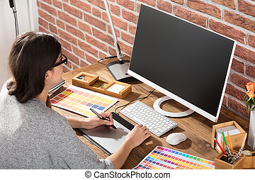 Female Graphic Designer Using Graphic Tablet