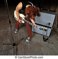 Female Guitarist - Image of a female guitarist playing in...