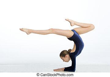 Female gymnast doing a handstand pose