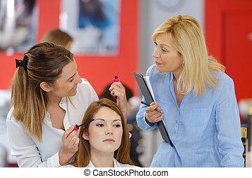 female hairdresser apprentice