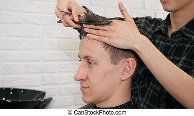 Female hairdresser haircut doing male hair style.