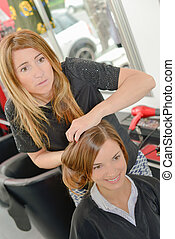 female hairdresser styling ladys hair