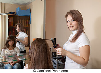 Female hairdresser working with girl