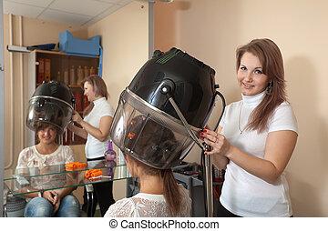 hairdresser working with hair dryer - Female hairdresser...