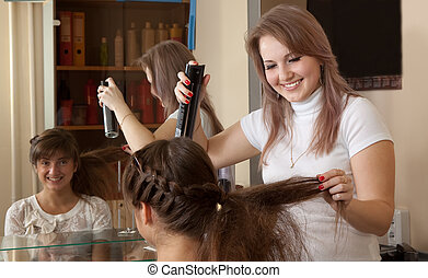 hairdresser works on woman hair - Female hairdresser works ...