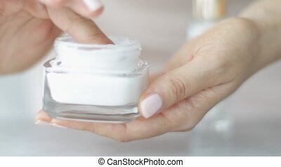 Female hand applying moisturizing cream or body lotion for healthy skin, woman and her skincare routine, organic cosmetic product and luxury beauty brand, stock footage