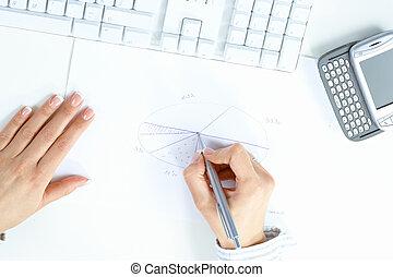 Female hand drawing chart