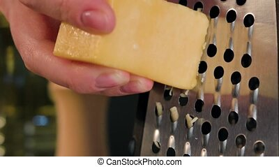 Female Hand Grating Cheese