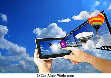 Female Hand hold digital tablet present Full HD 3D movie