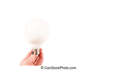 Female hand holding a big matte light bulb on white background