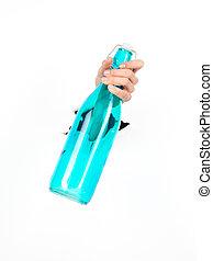 female hand holding a blue bottle