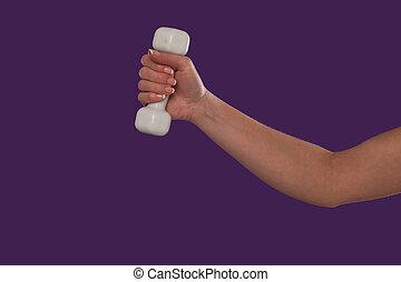 Female hand holding a dumbbell