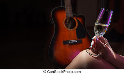 female hand holding a glass of champagne