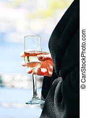 Female hand holding a glass of wine