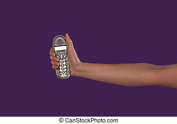 Female hand holding a remote control