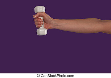 Female hand holding a small dumbbell