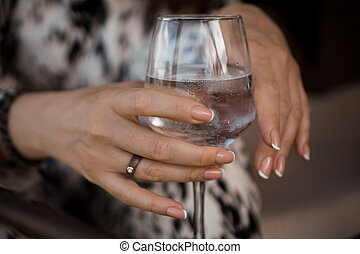 Female hand holding a wine glass