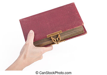female hand holding an old book with lock