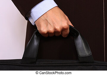 Female hand holding briefcase
