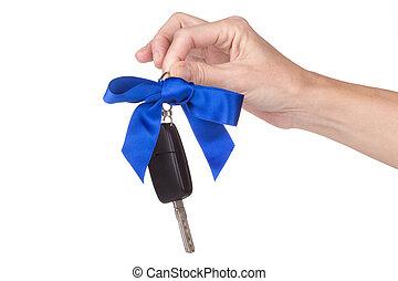 female hand holding car keys