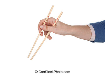 Female hand holding chopsticks with chinese inscription
