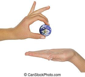 female hand holding earth.