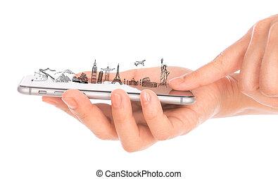 Female hand holding gold mobile phone smartphone travel around the world (Japan,France,Italy ,New York,India,egypt,china,london,brazil) .