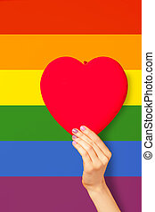Female hand holding heart shape symbol
