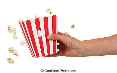 Female hand holding large square box popcorn on white. - A...