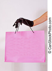 Female hand holding paper bag