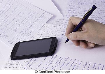 female hand holding pen using mobile phone