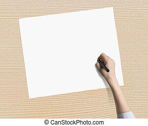 Female hand holding pen writing on blank white paper
