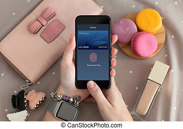 female hand holding phone with online shopping touch and pay