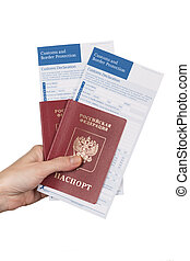 female hand holding russian travel passports