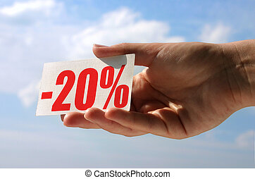 holding sale card - female hand holding sale card against...