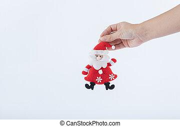 Female hand holding Santa figure on white background