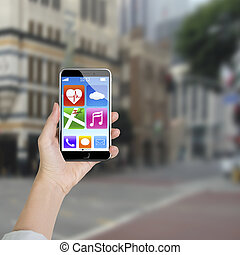 Female hand holding smartphone with app icons