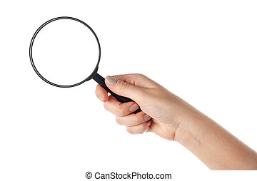 Female hand holding the magnifying glass (isolated) - Female...