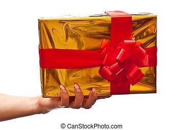 Female hand holding yellow gift box