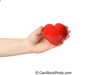 Female hand holds heart, isolated on white background
